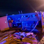 Lee's Summit Fire Department Pumper Rolls Onto Its Side On Icy Street