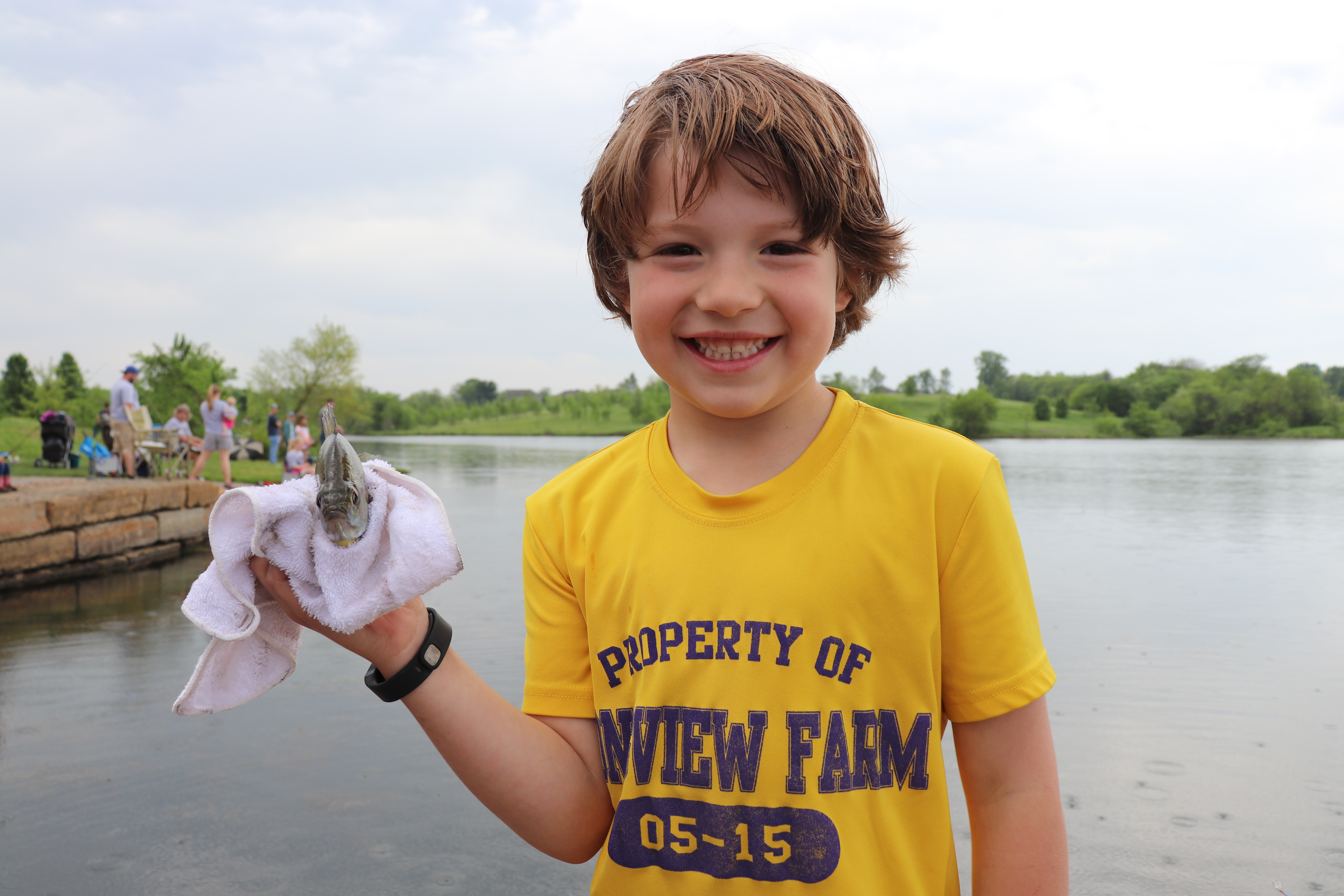 Image of a young boy holding a fish