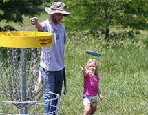 Image of people playing disc golf