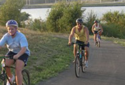 People riding bicycles on a trail