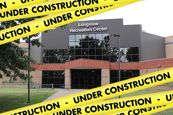 Image of Longview Community Center with Under Construction banners.