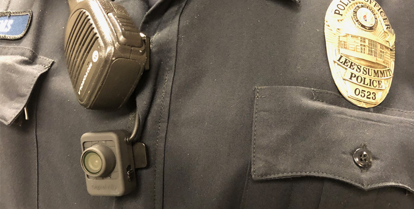 up close perspective of a police officer wearing a body-worn camera
