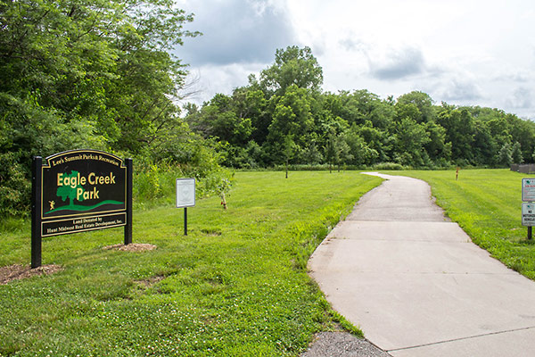 Image of Eagle Creek Park sign and walking trail