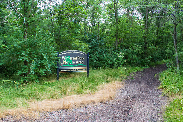 Image of Winterset Park Nature Area sign and trail
